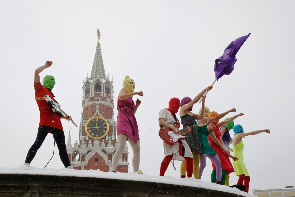 Members of the radical feminist punk group 'Pussy Riot' stage a protest against Vladimir Putin's policies at the so-called Lobnoye Mesto (Forehead Place), long before used for announcing Russian tsars' decrees and occasionally for carrying out public executions, in Red Square in Moscow.